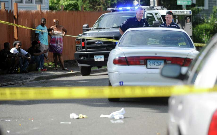 Police officers investigate at the scene where a 6-year-old girl was struck by a white sedan near 109 Dale Street in Stamford on Friday, August 10, 2012. Photo: Lindsay Niegelberg / Stamford Advocate