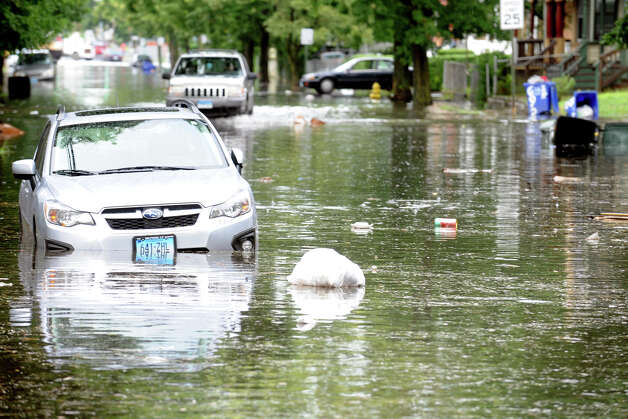 The scene along flooded Iranistan Ave., in Bridgeport, Conn. following Friday's storm, Aug. 10th, 2012. Photo: Ned Gerard / Connecticut Post