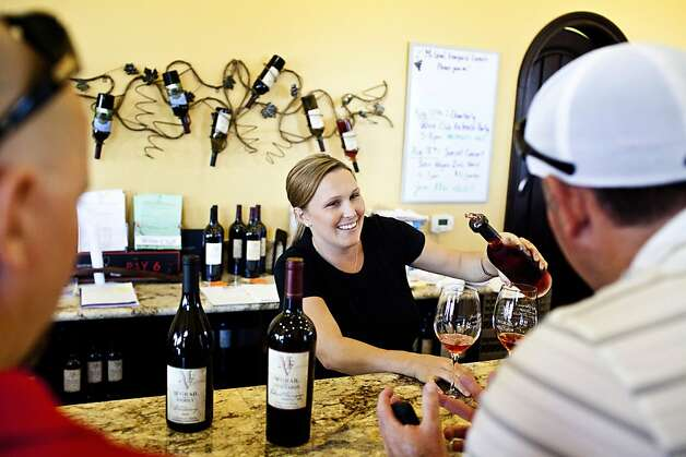 Heather McGrail pours in the tasting room at McGrail Vineyards, whose Cabernet has put it on the map.  The winery also offers private winemaker blending camps. Photo: Jason Henry, Special To The Chronicle
