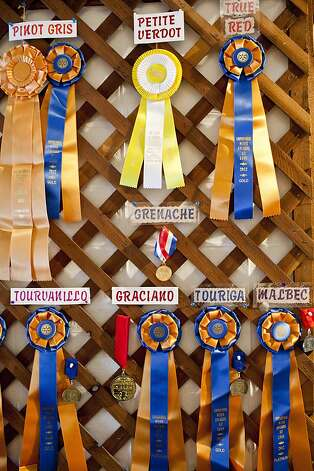 Awards hang on the wall at Fenestra Winery's tasting room in Livermore, Calif., August 1, 2012. Jason Henry/Special to The Chronicle Photo: Jason Henry, Special To The Chronicle