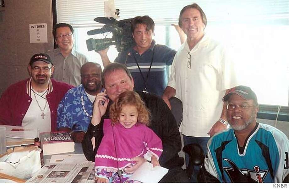 """Gary Radnich's 15th anniversary show on KNBR: From left: Sam Manneh, Ben Fong-Torres, """"Johnny the Gout Man,"""" Gary Radnich holding his daughter, Isabelle, """"Raider Mort"""" in white shirt and """"Bowler Bob."""" Guy with camera is from KRON and we don't have his name yet. Photo: Courtesy KNBR"""