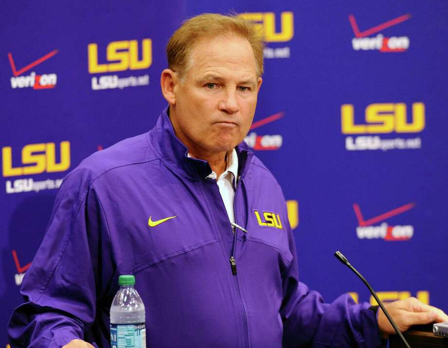 "LSU head NCAA college football coach Les Miles pauses while speaking at a news conference in Baton Rouge, La., Friday, Aug. 10, 2012.  Heisman Trophy finalist Tyrann Mathieu was kicked off LSU's football team Friday for breaking an athletic department rule, a blow to the Tigers' national championship hopes three weeks before their season opener.  ""We'll miss the guy,"" Miles said. ""The football team's got to go on. We'll have to fill the void."" (AP Photo/The Advocate,Travis Spradling) NO SALES, MAGS OUT, TV OUT, INTERNET OUT, MANDATORY CREDIT, NO FORNS. MAGS OUT / INTERNET  OUT/ONLINE OUT/NO SALES/TV OUT/FOREIGN OUT/ LOUISIANA BUSINESS INC./GREATER BATON ROUGE BUSINESS REPORT/225/10/12/IN REGISTER/LBI CUSTOM PUBLICATIONS OUT/ Photo: Travis Spalding, Associated Press / The Advacate"