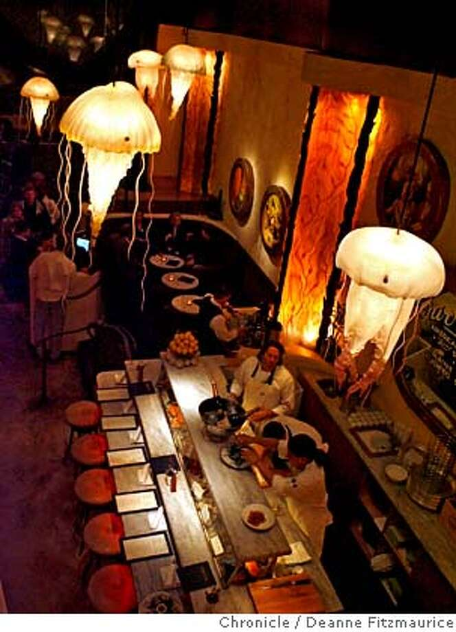 Jellyfish lights glow above the oyster bar at Farallon. Chronicle photo, 2007, by Deanne Fitzmaurice Photo: Deanne Fitzmaurice