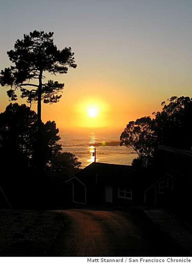 The cottages offer spectacular views of the sun setting over the sea. Photo: Matt Stannard, San Francisco Chronicle