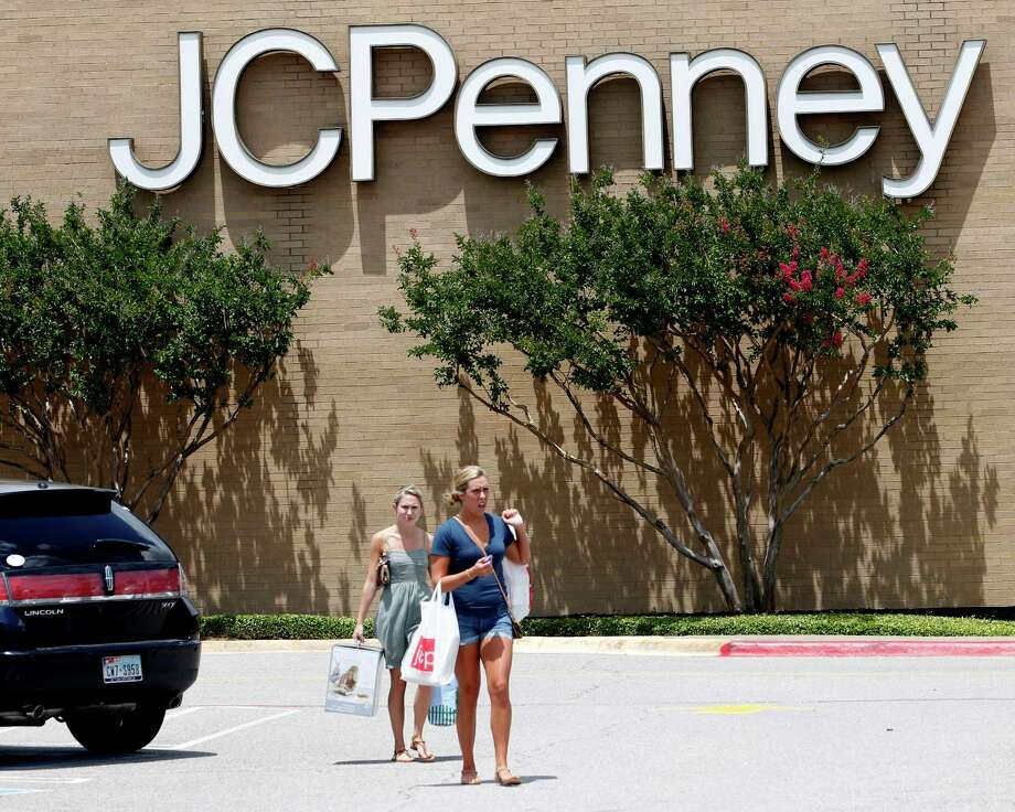 FILE - Shoppers walk in a parking lot outside of a JC Penney story in Plano, Texas,  in this June 19, 2012 file photo. J.C. Penney Co. is reporting a bigger-than-expected loss and plummeting sales, as its customers continue to be turned off by a new pricing plan that gets rid of hundreds of sales in favor of every day lower prices.  (AP Photo/LM Otero, File) Photo: LM Otero, Associated Press / AP