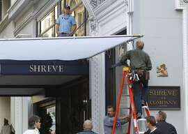 A production crew secures sun diffuser on the set of a new Woody Allen movie being filmed at Shreve and Co. jewelers at Post Street and Grant Avenue in San Francisco, Calif. on Friday, Aug. 10, 2012.