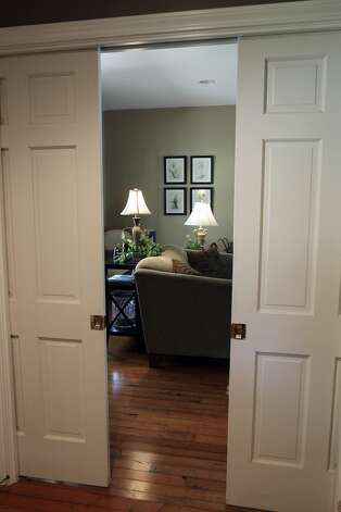 SPACES  TAYLOR  Pocket doors to living room.  Home of Amy Taylor in New Braunfels on August 8, 2012. (San Antonio Express-News)