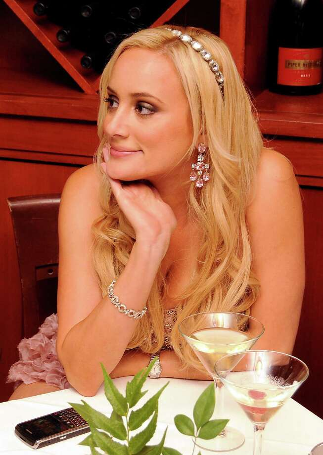 "Houston socialite Erica Rose is most famous for her reality TV role on ""The Bachelor: Rome,"" in which she was portrayed as a spoiled princess. She was then forced to earn her own keep on the VH1 show ""You're Cut Off,"" before returning to Houston to become a lawyer. Her website states she'd like to star in her own court show as a ""younger, hotter Judge Judy."" Photo: Dave Rossman / © 2011 Dave Rossman"