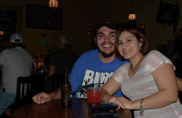 Patrick and Jessica Uresti (cq) take a break from pool to drink a few at Pirate Tavern on August 4, 2012. Robin Johnson