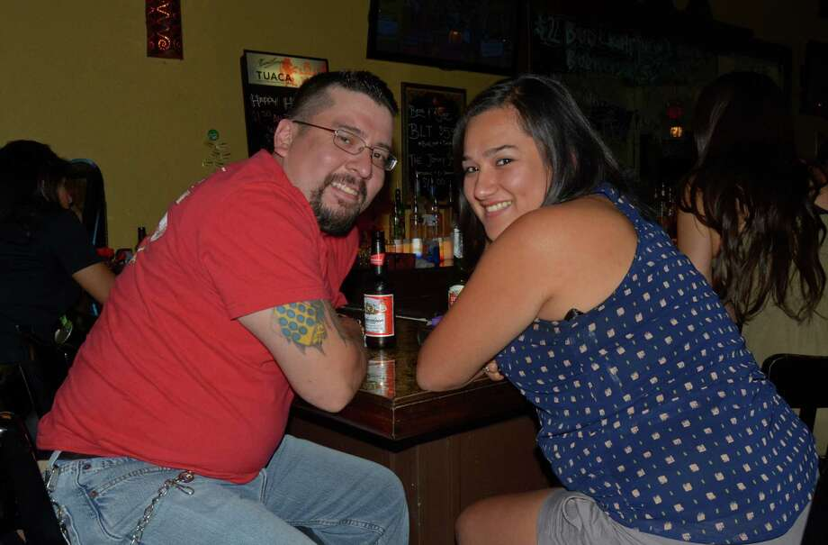David Ontiveros (cq) and Vanessa Perez spend their date night with drink specials at Pirate Tavern on August 4, 2012. Robin Johnson