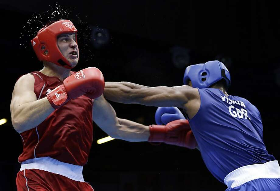 Kazakhstan's Ivan Dychko, left, fights Britain's Anthony Joshua in a super heavyweight over 91-kg semifinal boxing match at the 2012 Summer Olympics, Friday, Aug. 10, 2012, in London. (AP Photo/Patrick Semansky) Photo: Patrick Semansky, Associated Press