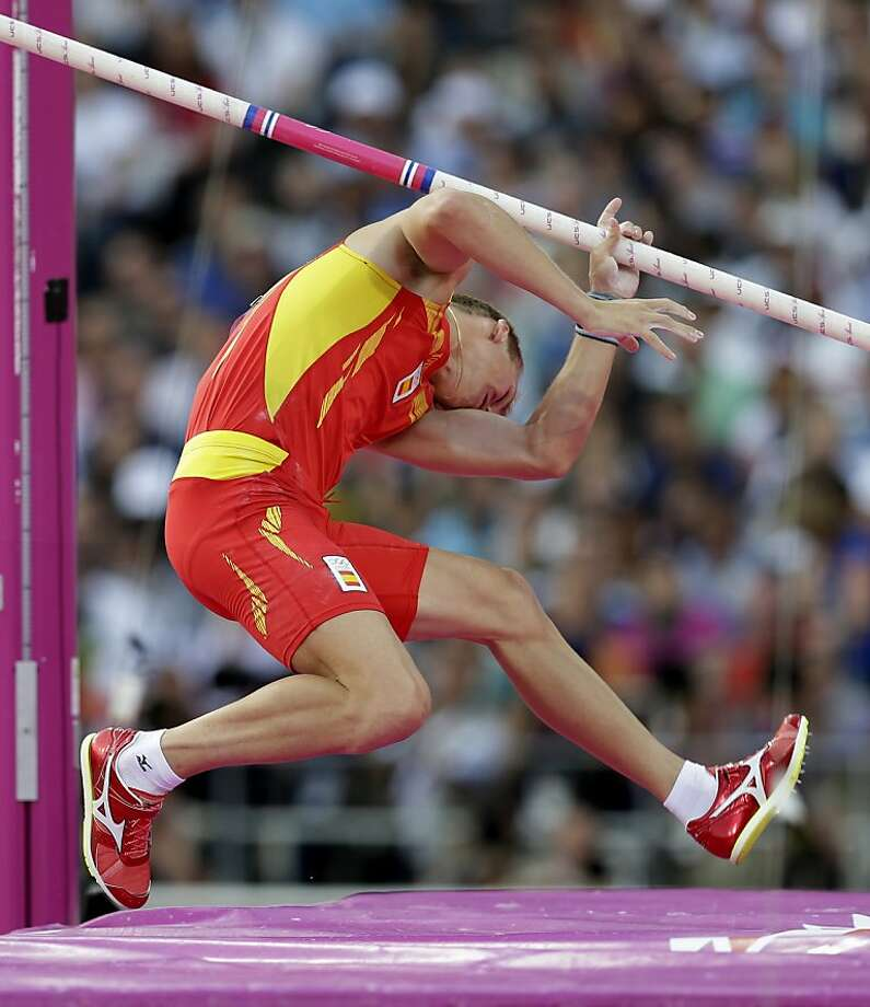 Spain's Igor Bychkov is hit by his pole as he fails to launch himself in the men's pole vault final during the athletics in the Olympic Stadium at the 2012 Summer Olympics, London, Friday, Aug. 10, 2012. (AP Photo/David J. Phillip) Photo: David J. Phillip, Associated Press