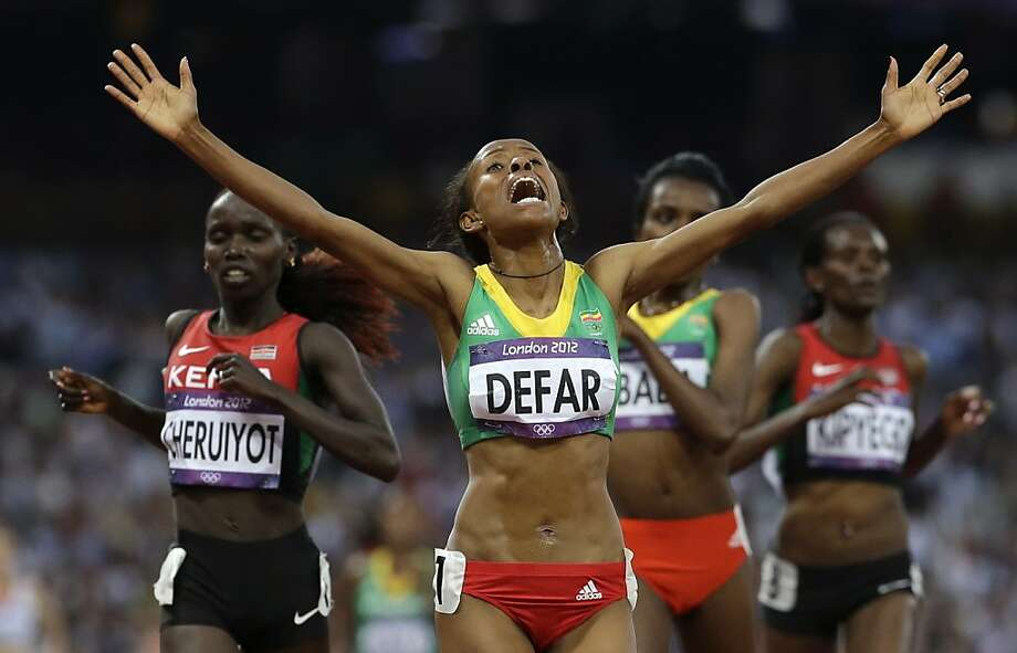 Ethiopia's Meseret Defar reacts as she crosses the finish line to win the 5000-meter final during the athletics in the Olympic Stadium at the 2012 Summer Olympics, London, Friday, Aug. 10, 2012. (AP Photo/Anja Niedringhaus) Photo: Anja Niedringhaus, Associated Press