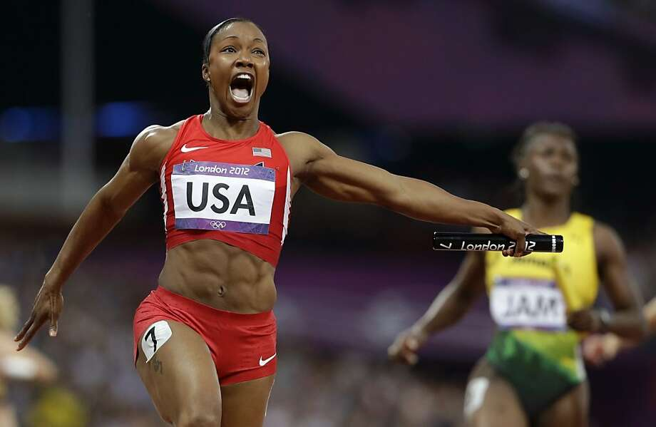 United States' Carmelita Jeter reacts as she crosses the finish line to win the women's 4 x 100-meter relay during the athletics in the Olympic Stadium at the 2012 Summer Olympics, London, Friday, Aug. 10, 2012. The United States relay team set a new world record with a time of 40.82 seconds.(AP Photo/Anja Niedringhaus) Photo: Anja Niedringhaus, Associated Press