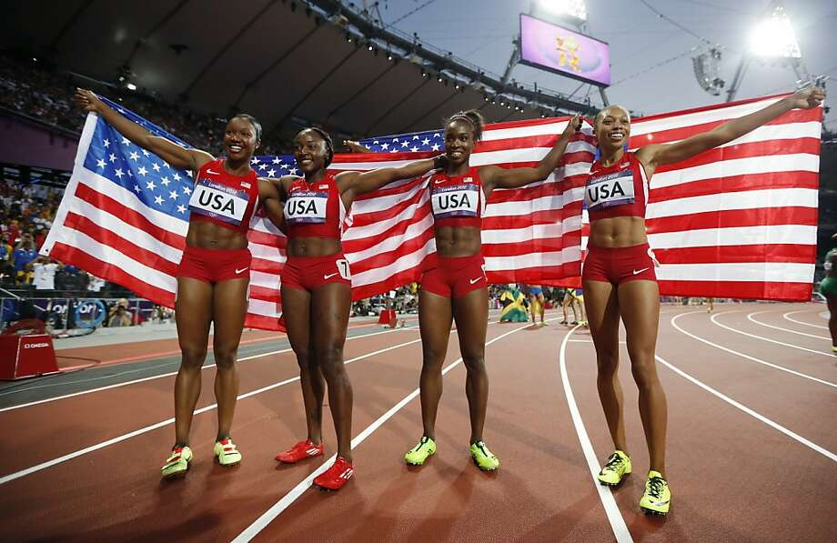United States' women's 4 x100-meter relay team members, from left, Carmelita Jeter, Bianca Knight, Tianna Madison and Allyson Felix, celebrate their gold medal win during the athletics in the Olympic Stadium at the 2012 Summer Olympics, London, Friday, Aug. 10, 2012. The United States relay team set a new world record with a time of 40.82 seconds (AP Photo/Matt Dunham) Photo: Matt Dunham, Associated Press