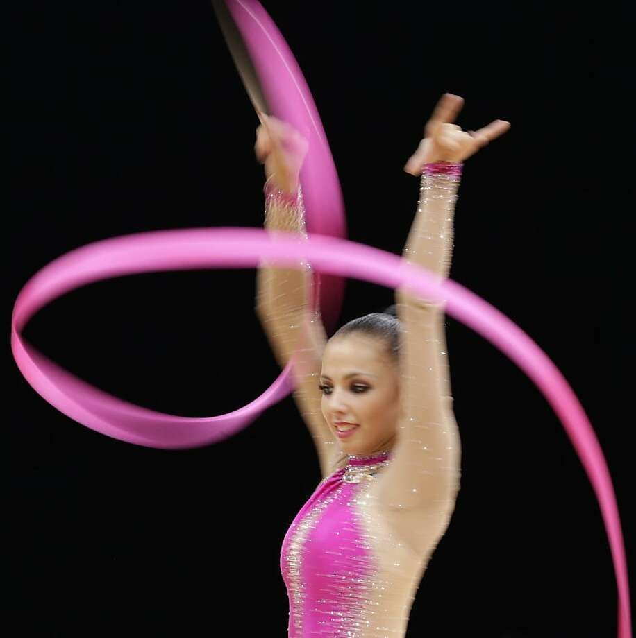 Russia's Daria Dmitrieva performs during the rhythmic gymnastics individual all-around qualifications  at the 2012 Summer Olympics, Friday, Aug. 10, 2012, in London. (AP Photo/Gregory Bull) Photo: Gregory Bull, Associated Press