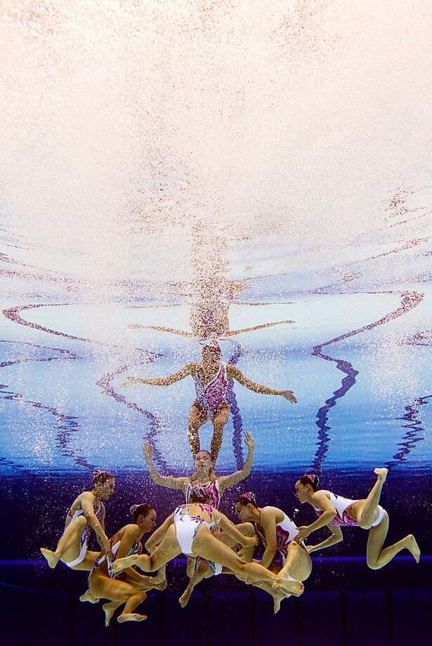 TOPSHOTS - PICTURE TAKEN WITH AN UNDERWATER CAMERA China's Wu Yiwen, China's Chen Xiaojun, China's Liu Ou, China's Jiang Wenwen, China's Chang Si, China's Jiang Tingting, China's Huang Xuechen and China's Luo Xi compete in the team free routine final during the synchronised swimming competition at the London 2012 Olympic Games on August 10, 2012 in London. AFP PHOTO / FRANCOIS XAVIER MARITFRANCOIS XAVIER MARIT/AFP/GettyImages Photo: Francois Xavier Marit, AFP/Getty Images