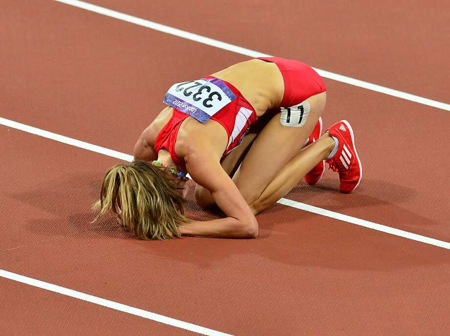 US' Morgan Uceny reacts after falling while competing  in the women's 1500m final at the athletics event of the London 2012 Olympic Games on August 10, 2012 in London.   AFP PHOTO / GABRIEL BOUYSGABRIEL BOUYS/AFP/GettyImages Photo: Gabriel Bouys, AFP/Getty Images