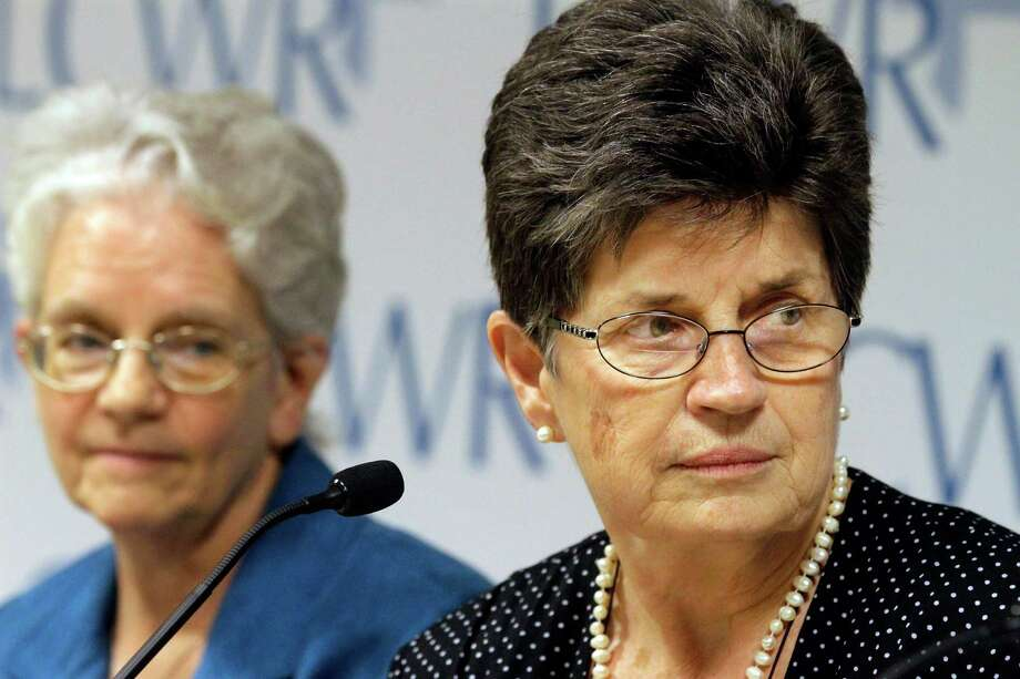 Outgoing President of The Leadership Conference of Women Religious Sister Pat Farrell, right, and president elect Sister Florence Deacon, left, listen to questions from reporters Friday, Aug. 10, 2012 in St. Louis. The largest U.S. group for Roman Catholic nuns got together to decide how they should respond to a Vatican rebuke and order for reform. The LCWR, represents most of the 57,000 American nuns. (AP Photo/Seth Perlman) Photo: Seth Perlman, Associated Press / AP