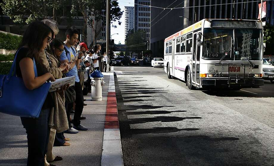Line of commuters waiting for the 31 Balboa Express after work on Davis St. between California and Market streets in San Francisco, Calif., on Thursday, August  11, 2012. Photo: Liz Hafalia, The Chronicle