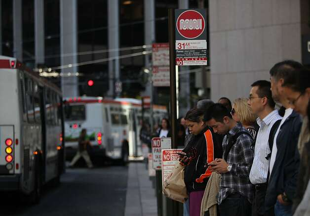 San Francisco commuters are waiting longer for buses that are more crowded now that Muni has been forced to cancel 650 trips per day. Photo: Liz Hafalia, The Chronicle