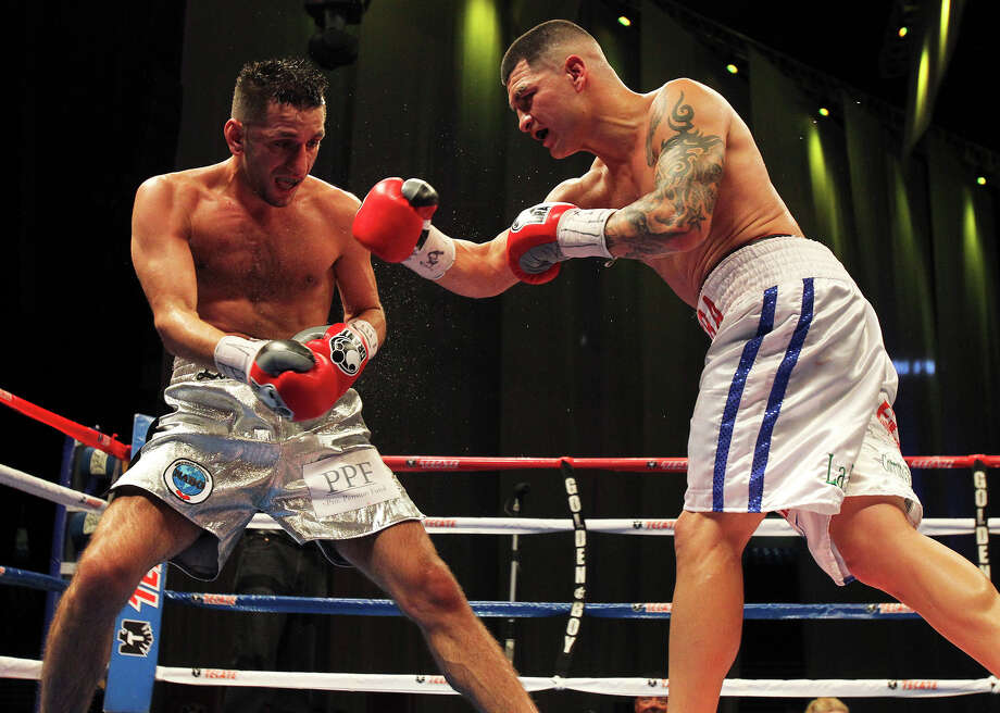 "In their last meeting Feb. 4, 2011, Brian Vera (right) beat Sergia Mora by split decision. ""I thought I did enough to win,"" Mora said. Vera replied: ""I thought I won unanimously."" Photo: Tom Reel, San Antonio Express-News / ©2012 San Antono Express-News"