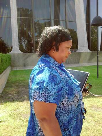 Janice Bernard leaves federal court  Friday, Aug. 10, 2011, after her husband, ex-SAWS manager Michael Bernard, was sentenced to 41 months in prison in a tax-protesting case. Photo by Guillermo Contreras Photo: GUILLERMO COTRERAS, San Antonio Express-News / San Antonio Express-News