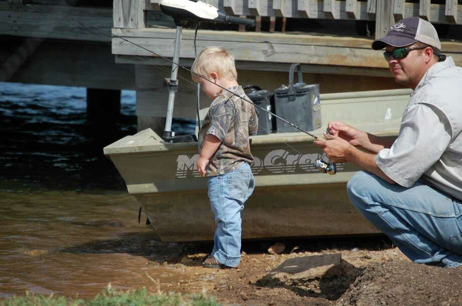 Shane Anderson and son Aaron enjoy their participation in the Dads Appreciating Down Syndrome's fishing event Aug. 4 at G.G. Gale Ranch. Photo: Courtesy Photo