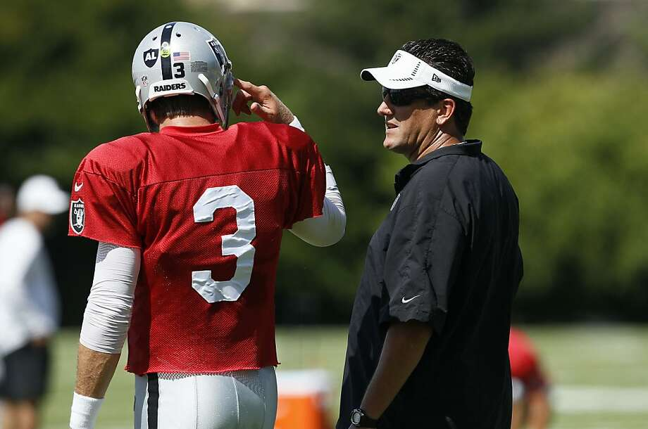 Offensive coordinator Greg Knapp (right) has been pleased by quarterback Carson Palmer's performance in camp. Photo: Jeff Chiu, Associated Press