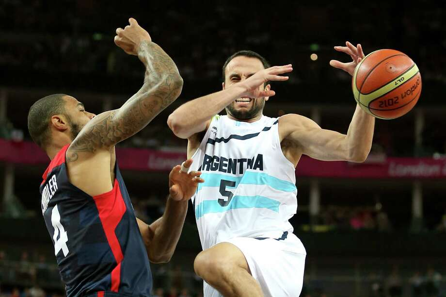 LONDON, ENGLAND - AUGUST 10:  Manu Ginobili #5 of Argentina looses the ball against Tyson Chandler #4 of United States in the first half during the Men's Basketball semifinal match on Day 14 of the London 2012 Olympic Games at the Basketball Arena on August 10, 2012 in London, England. Photo: Christian Petersen, Getty Images / 2012 Getty Images