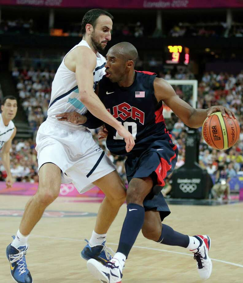 United States' Kobe Bryant, right, drives to the basket against Argentina's Manu Ginobili during a men's semifinals basketball game at the 2012 Summer Olympics, Friday, Aug. 10, 2012, in London. (AP Photo/Charles Krupa) Photo: Charles Krupa, Associated Press / AP