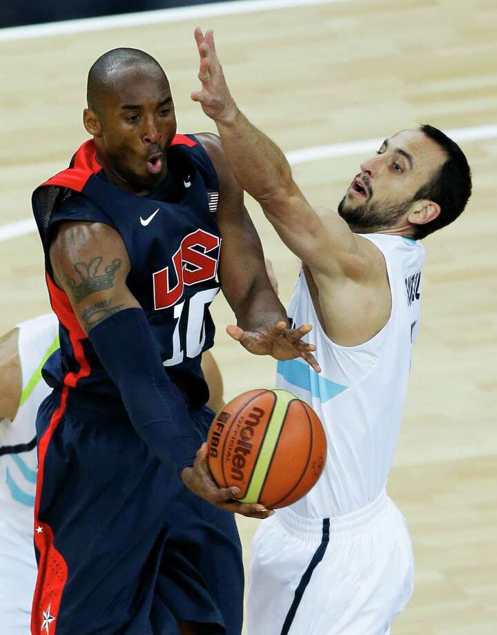 United States' Kobe Bryant, is defended by Argentina's Manu Ginobili, right, during a men's basketball semifinal game at the 2012 Summer Olympics, Friday, Aug. 10, 2012, in London. (AP Photo/Victor R. Caivano) Photo: Victor R. Caivano, Associated Press / AP