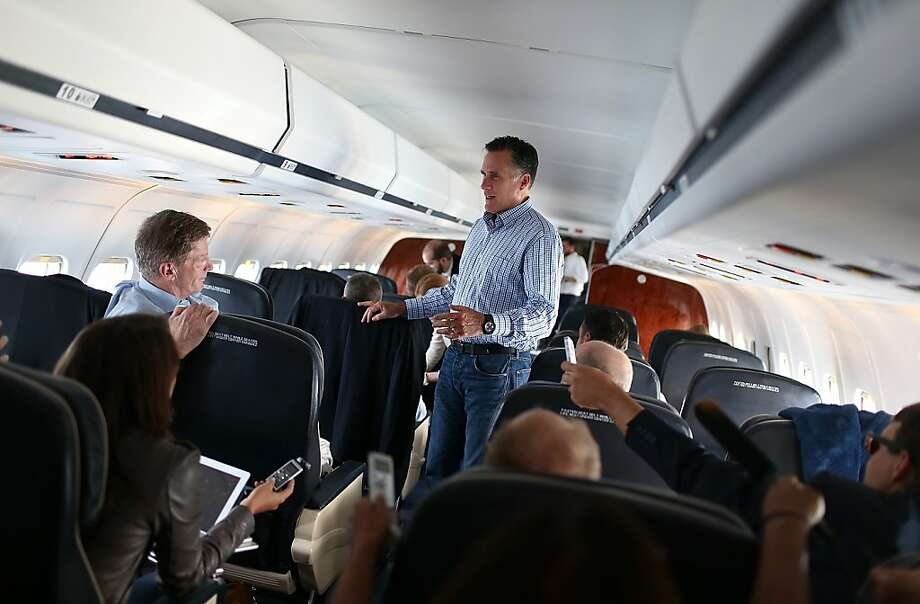 Mitt Romney talks with reporters on a flight to Virginia, where he will begin  a four-day bus tour, with stops in Florida, North Carolina and Ohio. Photo: Justin Sullivan, Getty Images
