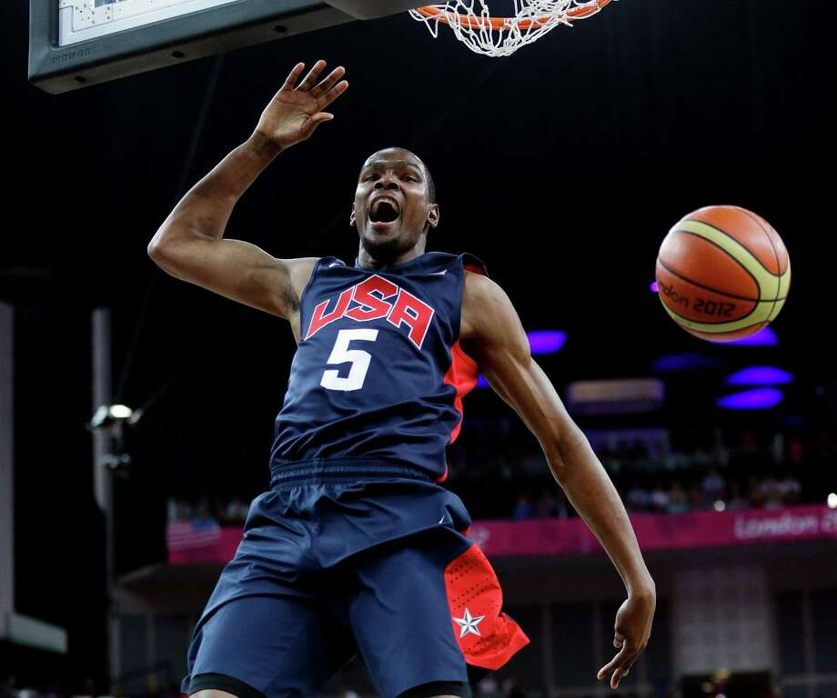 United States' Kevin Durant (5) reacts after he slam dunks against Argentina during a semifinal men's basketball game at the 2012 Summer Olympics, Friday, Aug. 10, 2012, in London. (AP Photo/Eric Gay) Photo: Eric Gay, Associated Press / AP