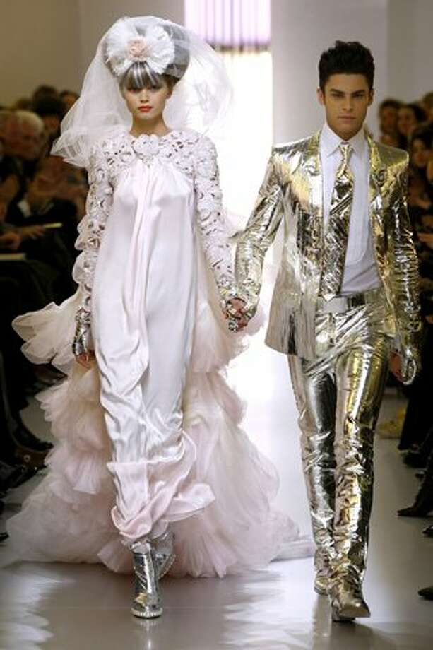 His and hers future Monster looks from Chanel's Spring 2010 Couture collection. Nothing says pop star marriage like matching silver lamé.  (Monica Feudi)