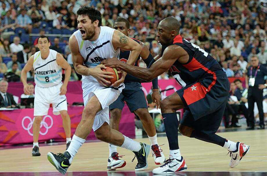 Argentinian guard Carlos Delfino (L) is challenged by US guard Kobe Bryant vies for the ball during the London 2012 Olympic Games men's semifinal basketball game between Argentina and the USA at the North Greenwich Arena in London on August 10, 2012. AFP PHOTO /TIMOTHY A.  CLARYTIMOTHY A. CLARY/AFP/GettyImages Photo: TIMOTHY A. CLARY, AFP/Getty Images / AFP