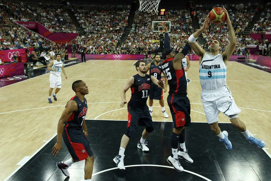 Argentina's Juan Gutierrez (R) shoots over Carmelo Anthony (2nd R) of the US during the London 2012 Olympic Games men's semifinal basketball game between Argentina and the USA at the North Greenwich Arena in London on August 10, 2012. AFP PHOTO/ POOL/SERGIO PEREZSERGIO PEREZ/AFP/GettyImages Photo: SERGIO PEREZ, AFP/Getty Images / AFP
