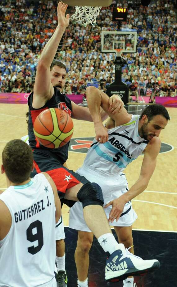 Argentinian centre Juan Pedro Gutierrez (L) and Argentinian guard Emanuel Ginobili (R) challenge US forward Kevin Love during the London 2012 Olympic Games men's semifinal basketball game between Argentina and the USA at the North Greenwich Arena in London on August 10, 2012. AFP PHOTO/ POOL/MARK RALSTONMARK RALSTON/AFP/GettyImages Photo: MARK RALSTON, AFP/Getty Images / AFP