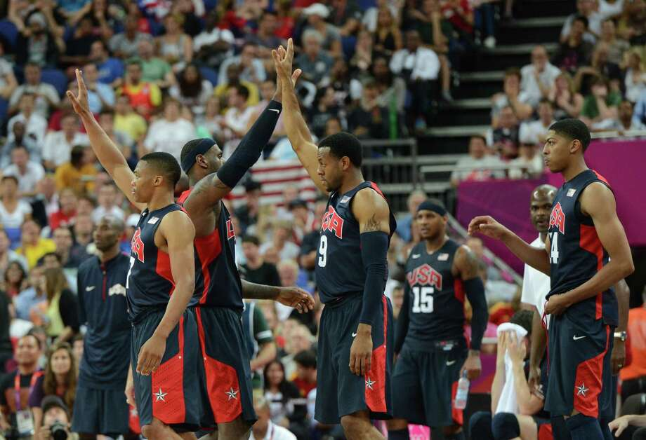US players celebrate after winning 109-83 against Argentina during the London 2012 Olympic Games men's semifinal basketball game between Argentina and the USA at the North Greenwich Arena in London on August 10, 2012. AFP PHOTO /MARK RALSTONMARK RALSTON/AFP/GettyImages Photo: MARK RALSTON, AFP/Getty Images / AFP