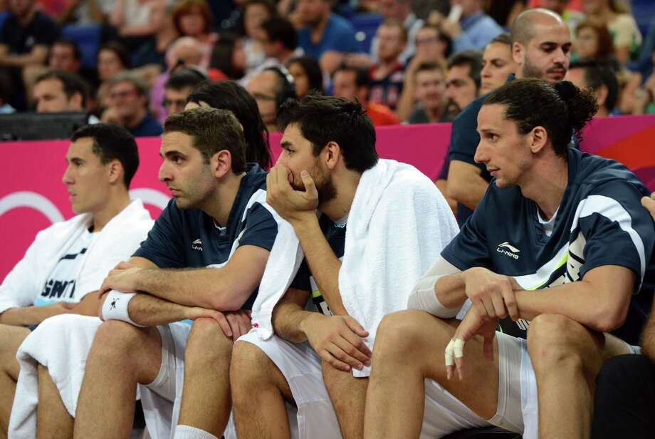 Argentinian players sit on the sidelines after losing 109-83 to the USduring the London 2012 Olympic Games men's semifinal basketball game between Argentina and the USA at the North Greenwich Arena in London on August 10, 2012. AFP PHOTO /MARK RALSTONMARK RALSTON/AFP/GettyImages Photo: MARK RALSTON, AFP/Getty Images / AFP