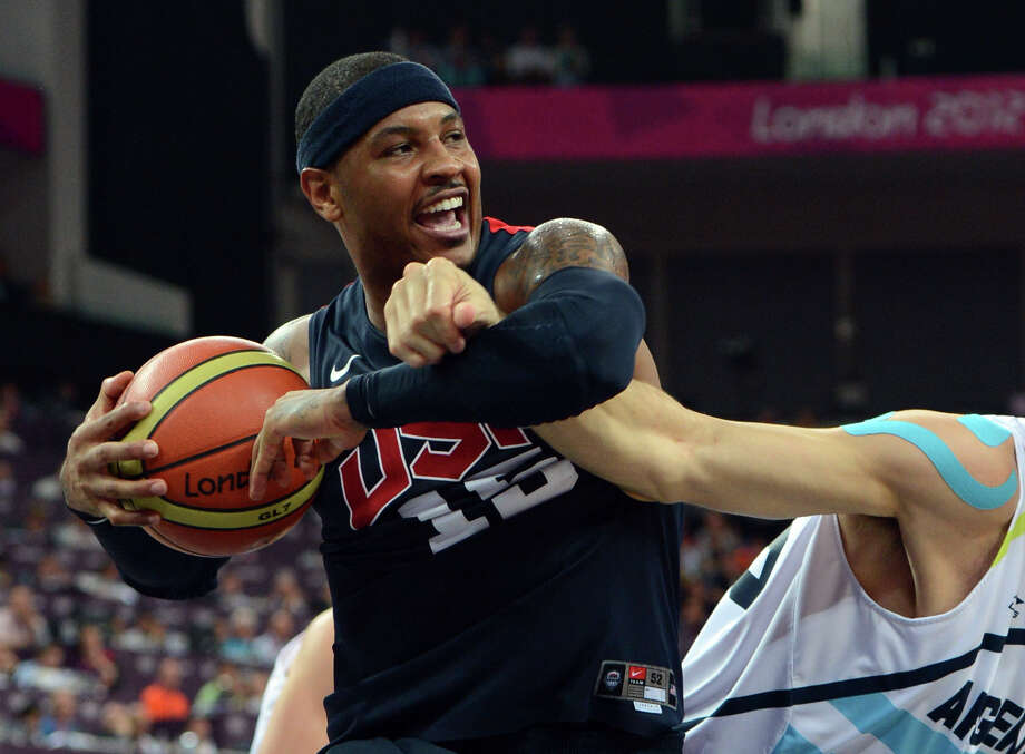US forward Carmelo Anthony vies for the ball during the London 2012 Olympic Games men's semifinal basketball game between Argentina and the USA at the North Greenwich Arena in London on August 10, 2012. AFP PHOTO /MARK RALSTONMARK RALSTON/AFP/GettyImages Photo: MARK RALSTON, AFP/Getty Images / AFP