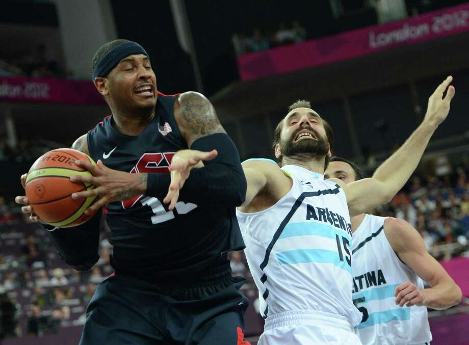 US forward Carmelo Anthony (L) vies for the ball with Argentinian forward Federico Kammerichs during the London 2012 Olympic Games men's semifinal basketball game between Argentina and the USA at the North Greenwich Arena in London on August 10, 2012. AFP PHOTO /MARK RALSTONMARK RALSTON/AFP/GettyImages Photo: MARK RALSTON, AFP/Getty Images / AFP
