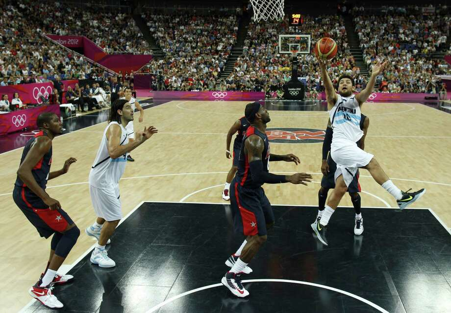 LONDON, ENGLAND - AUGUST 10: Carlos Delfino (R) of Argentina throws up a shot during the Men's Basketball semi-final match between Argentina and the USA on Day 14 of the London 2012 Olympic Games at North Greenwich Arena on August 10, 2012 in London, England. Photo: Pool, Getty Images / 2012 Getty Images