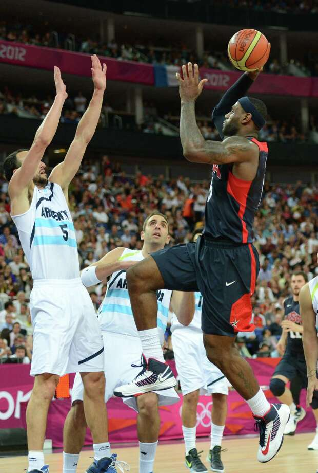 Argentinian guard Emanuel Ginobili (L) challenges US forward LeBron James during the London 2012 Olympic Games men's semifinal basketball game between Argentina and the USA at the North Greenwich Arena in London on August 10, 2012. AFP PHOTO /TIMOTHY A.  CLARYTIMOTHY A. CLARY/AFP/GettyImages Photo: TIMOTHY A. CLARY, AFP/Getty Images / AFP