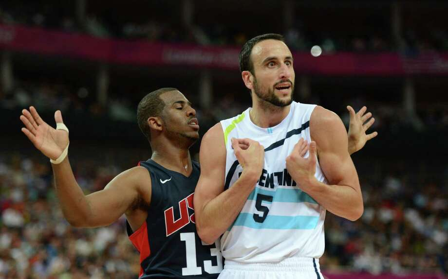 Argentinian guard Emanuel Ginobili (R) is challenged by US guard Chris Paul during the London 2012 Olympic Games men's semifinal basketball game between Argentina and the USA at the North Greenwich Arena in London on August 10, 2012. AFP PHOTO /TIMOTHY A.  CLARYTIMOTHY A. CLARY/AFP/GettyImages Photo: TIMOTHY A. CLARY, AFP/Getty Images / AFP