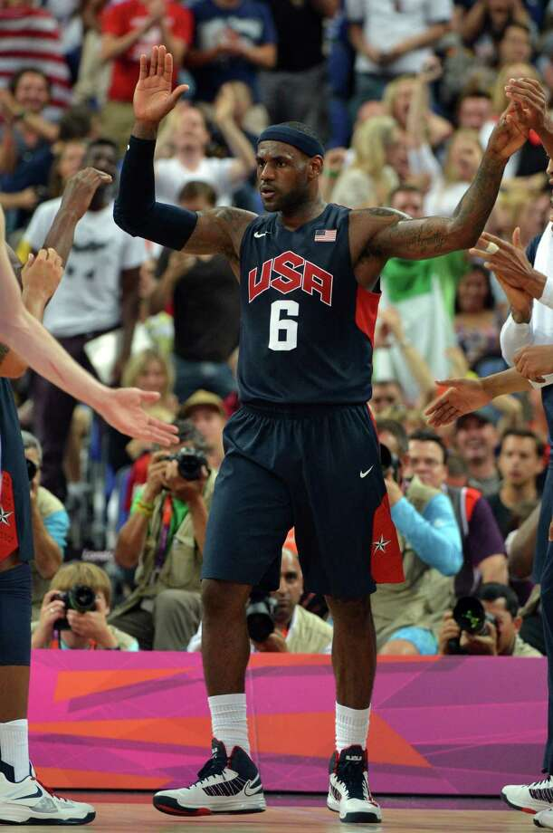 US forward LeBron James celebrates scoring during the London 2012 Olympic Games men's semifinal basketball game between Argentina and the USA at the North Greenwich Arena in London on August 10, 2012. AFP PHOTO /MARK RALSTONMARK RALSTON/AFP/GettyImages Photo: MARK RALSTON, AFP/Getty Images / AFP