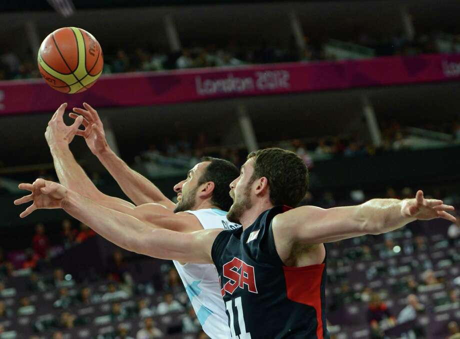 US forward Kevin Love (front) challenges Argentinian guard Emanuel Ginobili during the London 2012 Olympic Games men's semifinal basketball game between Argentina and the USA at the North Greenwich Arena in London on August 10, 2012. AFP PHOTO /MARK RALSTONMARK RALSTON/AFP/GettyImages Photo: MARK RALSTON, AFP/Getty Images / AFP
