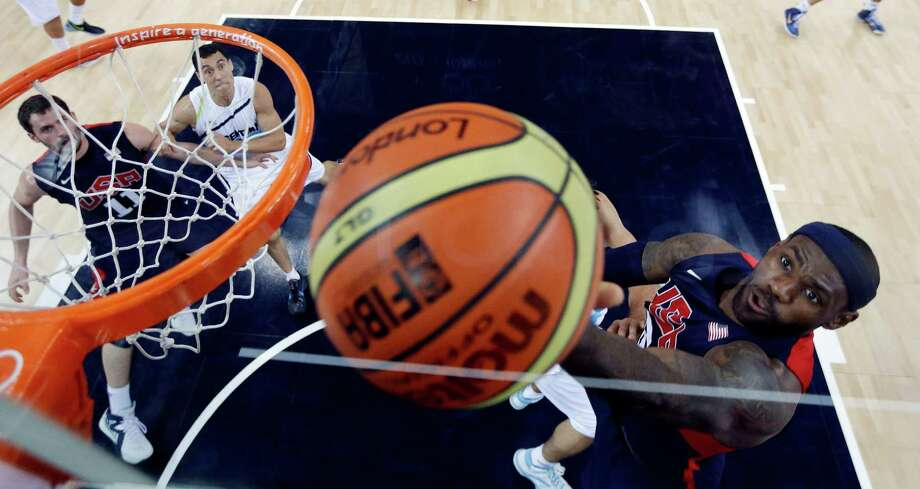 LeBron James (R) of the US scores against Argentina during the London 2012 Olympic Games men's semifinal basketball game between Argentina and the USA at the North Greenwich Arena in London on August 10, 2012. AFP PHOTO /POOL/ERIC GAYERIC GAY/AFP/GettyImages Photo: ERIC GAY, AFP/Getty Images / AFP