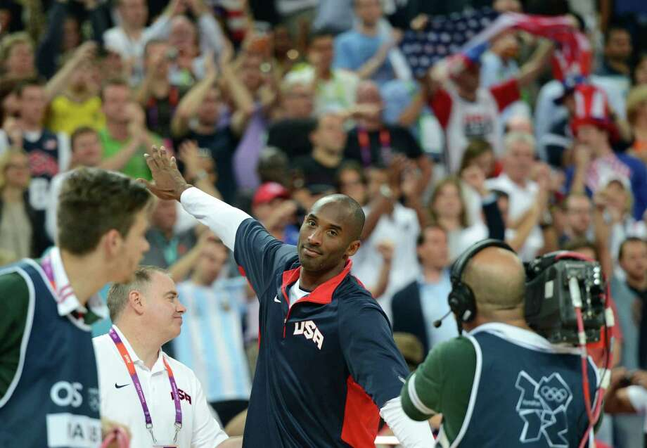 US guard Kobe Bryant celebrates after winning 109-83 against Argentina during the London 2012 Olympic Games men's semifinal basketball game between Argentina and the USA at the North Greenwich Arena in London on August 10, 2012. AFP PHOTO /TIMOTHY A.  CLARYTIMOTHY A. CLARY/AFP/GettyImages Photo: TIMOTHY A. CLARY, AFP/Getty Images / AFP
