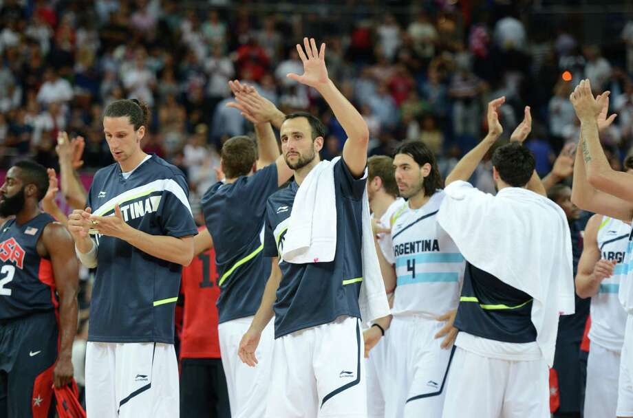 Argentinian players acknowledge the crowds after losing 109-83 to the US during the London 2012 Olympic Games men's semifinal basketball game between Argentina and the USA at the North Greenwich Arena in London on August 10, 2012. AFP PHOTO /TIMOTHY A.  CLARYTIMOTHY A. CLARY/AFP/GettyImages Photo: TIMOTHY A. CLARY, AFP/Getty Images / AFP